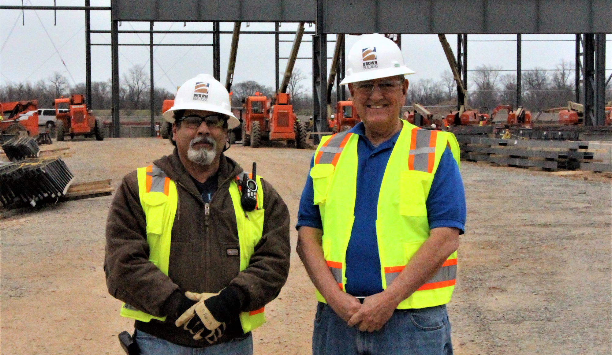 Wayne Brown w/ employee at construction site